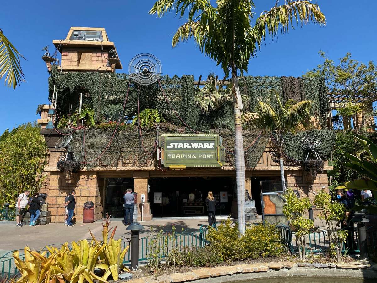 The old Rainforest Cafe in Downtown Disney has reopened as the Star Wars Trading Post. In this photo, legacy passholders visit Feb. 17, 2021.