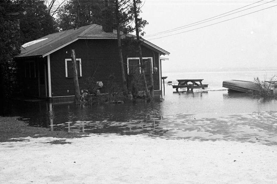 The spring-like thaw of this past week caused flooding in the Bar Lake area. The photo was published on the front page of the News Advocate on this day in 1981. (Manistee County Historical Museum photo)