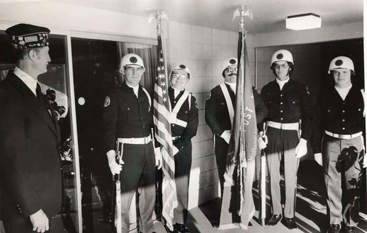 Jack Burrell, left, commander of the Midland American Legion, Berryhill Post 165, posts colors with the Legion Color Guard in advance of the state seminar at the Legion building. Others from left, James St. Onge, Norman Piegols, Thomas Robel, Richard Bradley and Randy A. Gellette. February 1976
