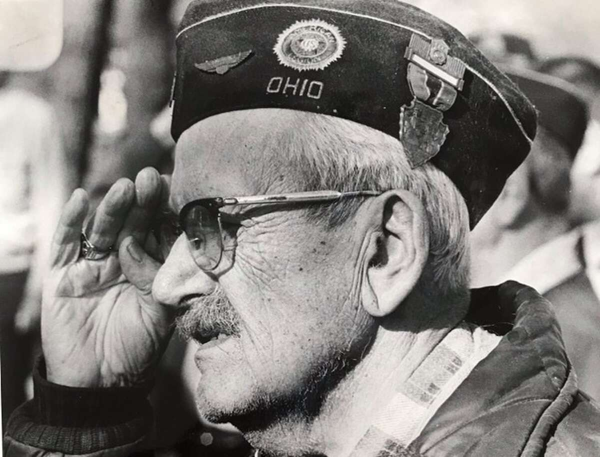 The playing of Taps brings back memories of World War I as Donald M. Caulkins of Mill Street salutes in concluding ceremonies on Veterans Day at the Veterans Plaque. Caulkins served from Ohio in the