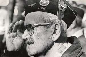"""The playing of Taps brings back memories of World War I as Donald M. Caulkins of Mill Street salutes in concluding ceremonies on Veterans Day at the Veterans Plaque. Caulkins served from Ohio in the """"War to End All Wars."""" November 1975"""