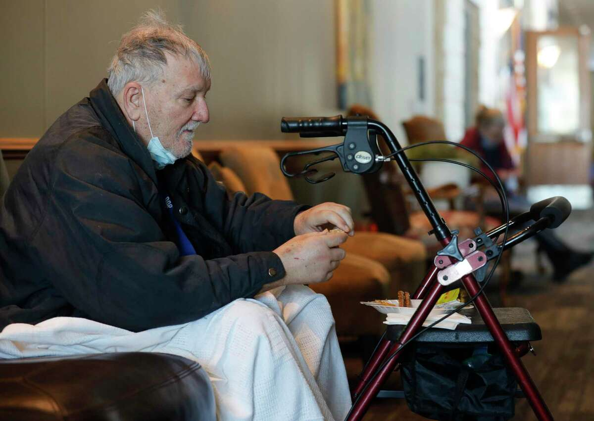 """Lee Anderson eats breakfast at a shelter setup at the Lone Star Convention & Expo Center, Tuesday in Conroe. """"I don't have power at my home and I have several health issues, so the police brought me here,"""" Anderson said. """"I'm Dialysis scheduled for tomorrow, so I'm not sure what I'm going to do about my treatment. Guess I'll call and hope they are open tomorrow. Not sure how I'm going to get there though."""" The winter weather has created some challenges for Montgomery County emergency officials who are now seeking new locations to serve as warming centers."""
