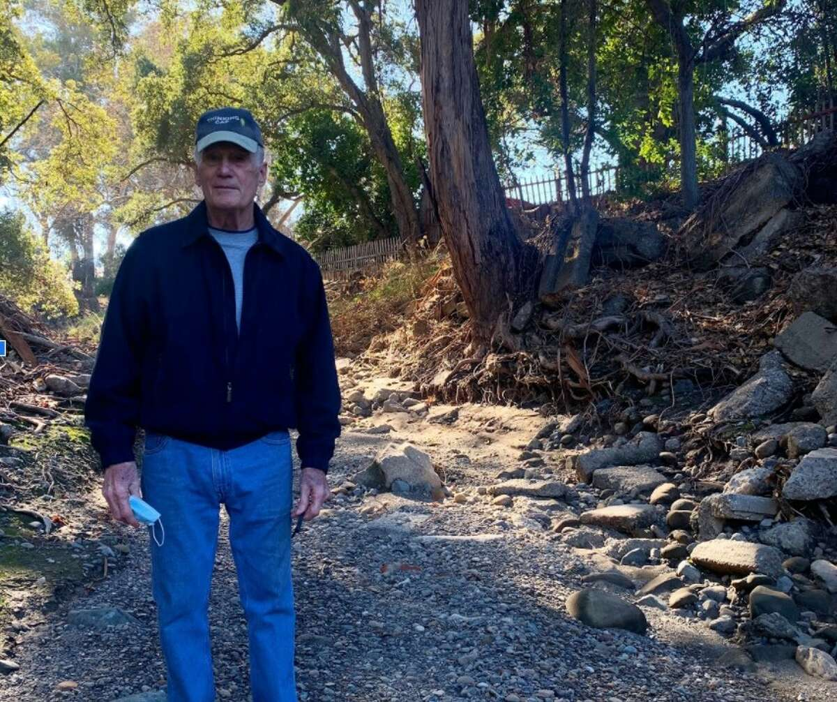 Phil Livengood, a retired U.S. Navy pilot and 50-year Saratoga Creek resident, stands in the Saratoga Creek bed next to his backyard. Part of what he believed was his property will be reclaimed by the Santa Clara Valley Water District for the restoration project.