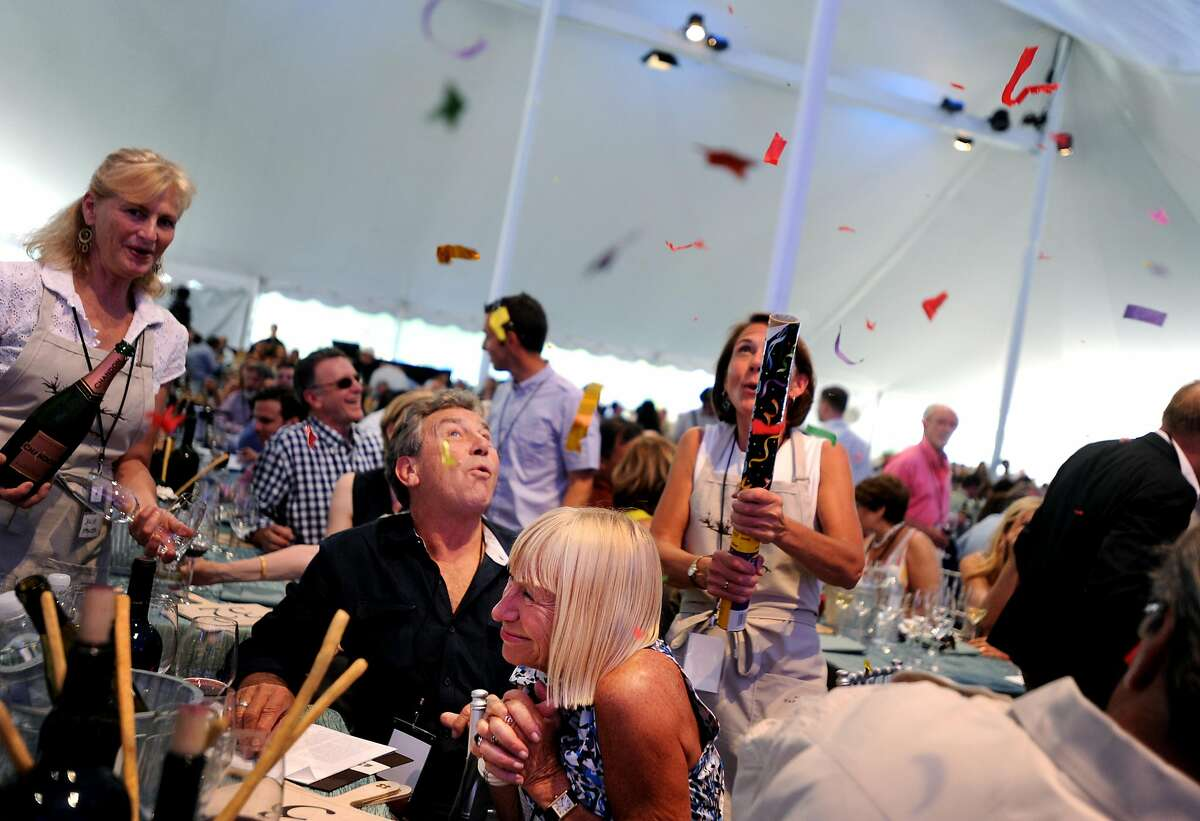 Mitch Soekland and Mary Miner celebrate after winning Lot 10 for $55 thousand during Auction Napa Valley 2012 held at Meadowood resort in St. Helena, California. June 2, 2012.