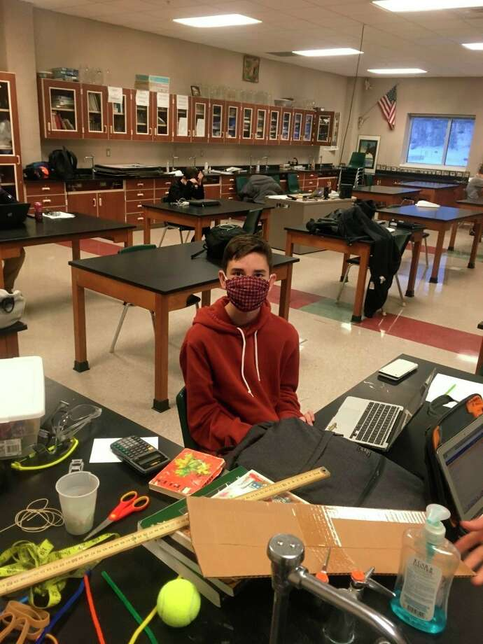 Manistee's Dylan Madsen poses for a photo Saturday during theWest Ottawa Science Olympiad tournament. Manistee High School had two teams competing remotely. (Courtesy photo)