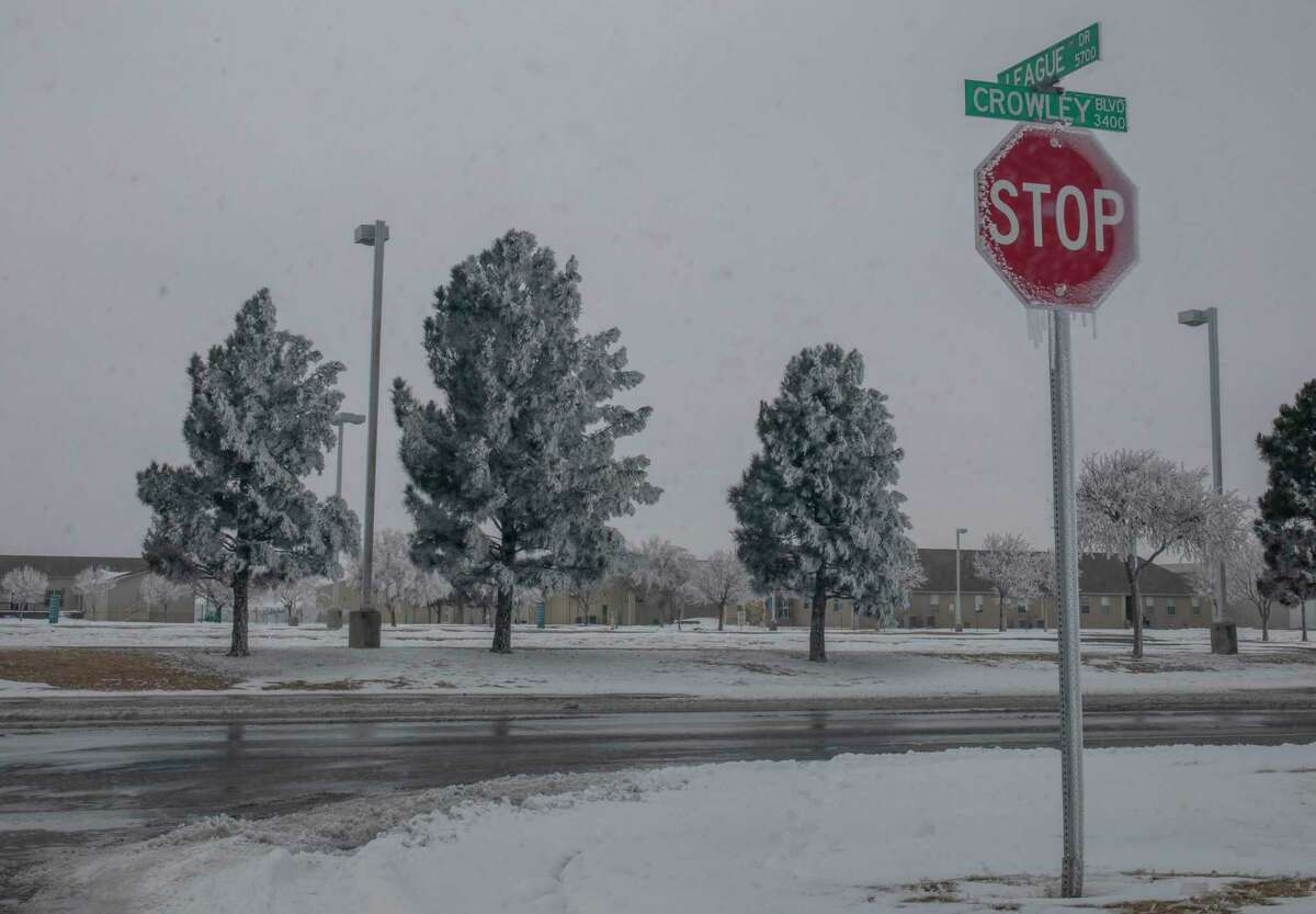 A stop sign is covered in icicles Wednesday, Feb. 17, 2021 at the corner of League Drive and Crowley Blvd. Jacy Lewis/ Reporter-Telegram