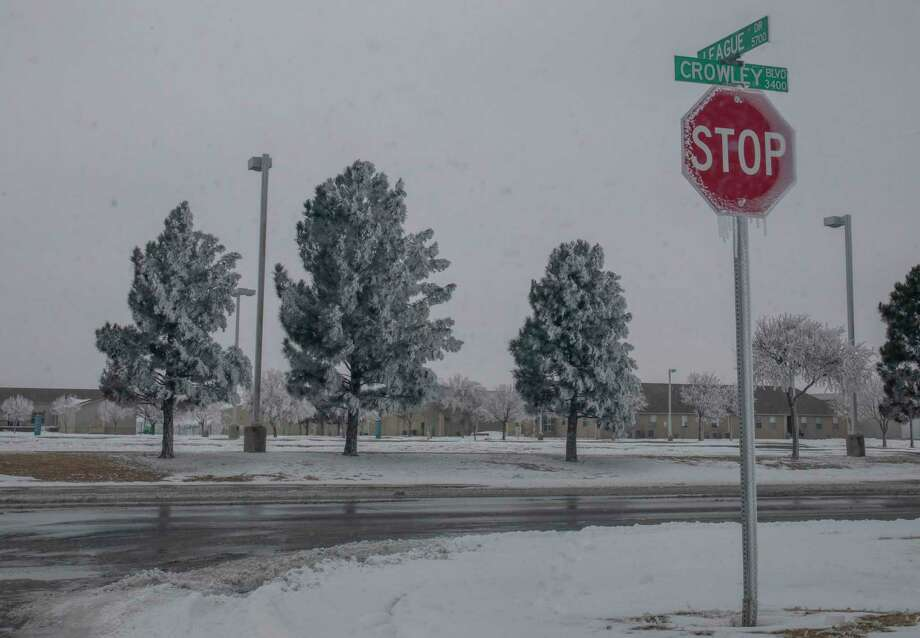 A stop sign is covered in icicles Wednesday, Feb. 17, 2021 at the corner of League Drive and Crowley Blvd.   Jacy Lewis/ Reporter-Telegram Photo: Jacy Lewis/ Reporter-Telegram
