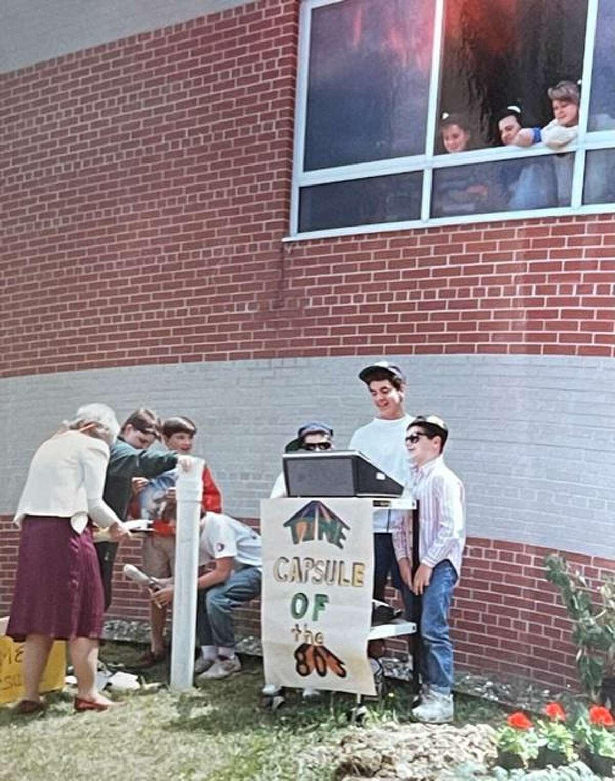 East Ridge Middle School students bury a time capsule on June 6, 1990.
