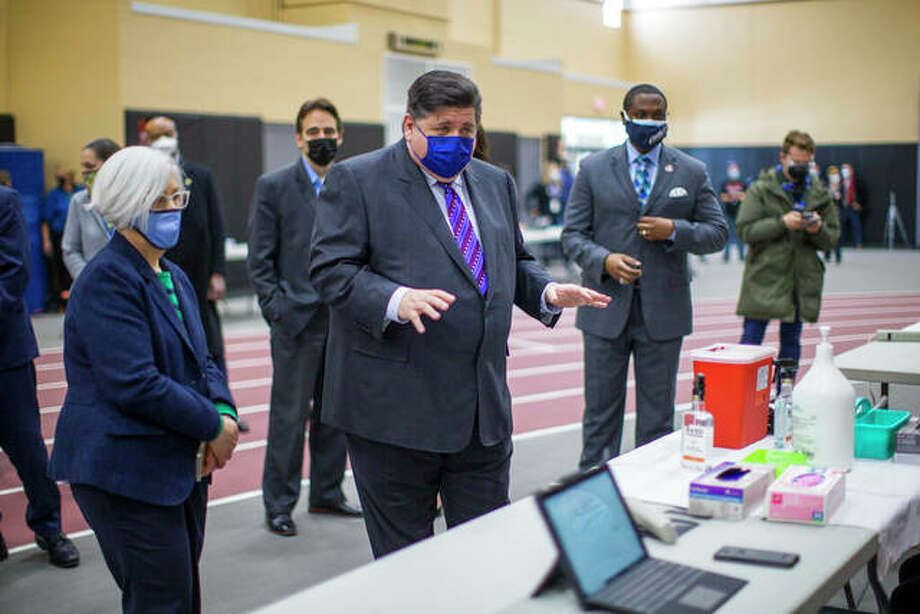 Gov. J.B. Pritzker and Winnebago County health administrator Sandra Martell (left) tour a vaccination center at Auburn High School earlier this month. Pritzker on Wednesday proposed a $41.6 billion state budget for the coming fiscal year. Photo: Scott P. Yates | Rockford Register Star (AP)
