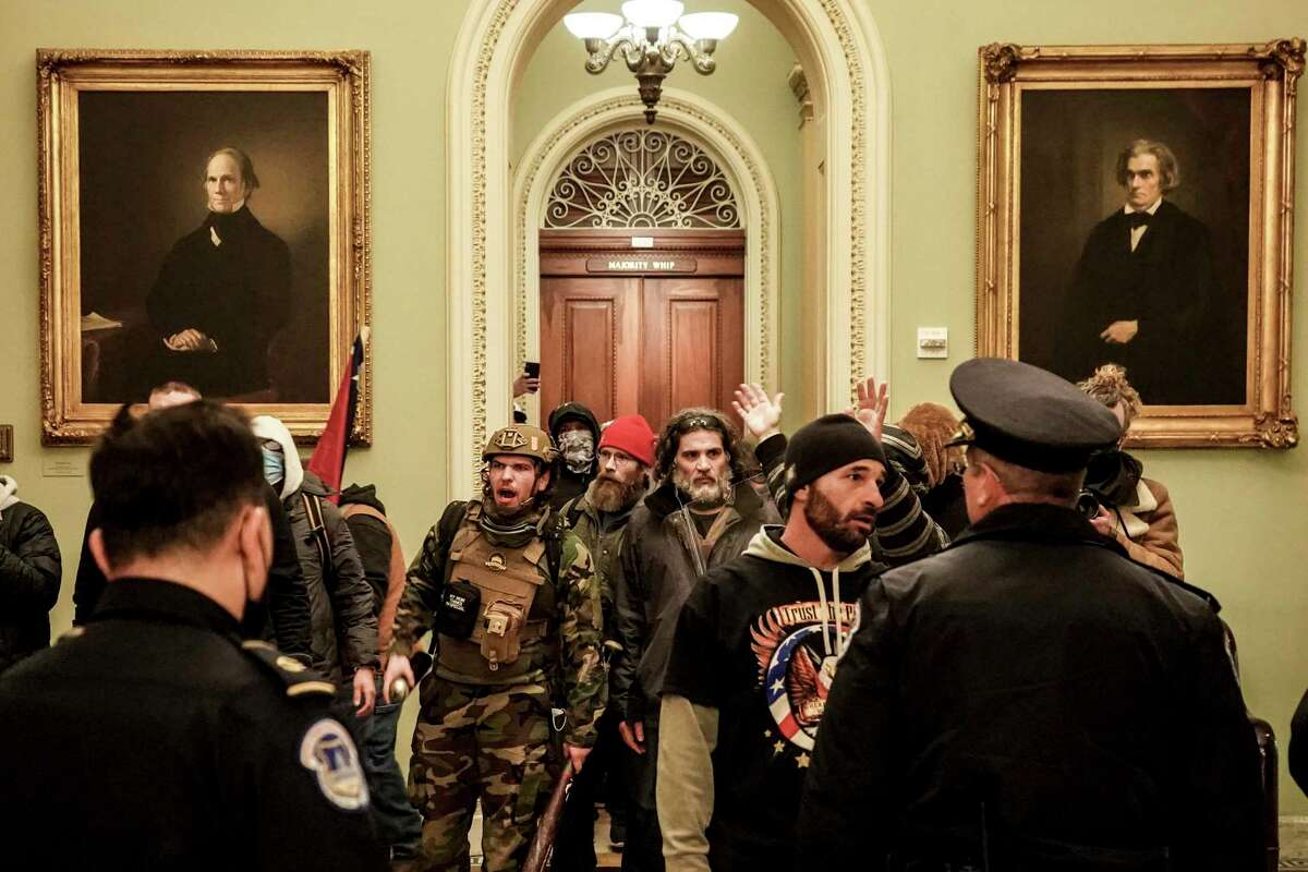 Dominic Pezzola, center right, a former Marine and member of the Proud Boys, confronts police inside the Capitol. How do we root out extremism in the military?
