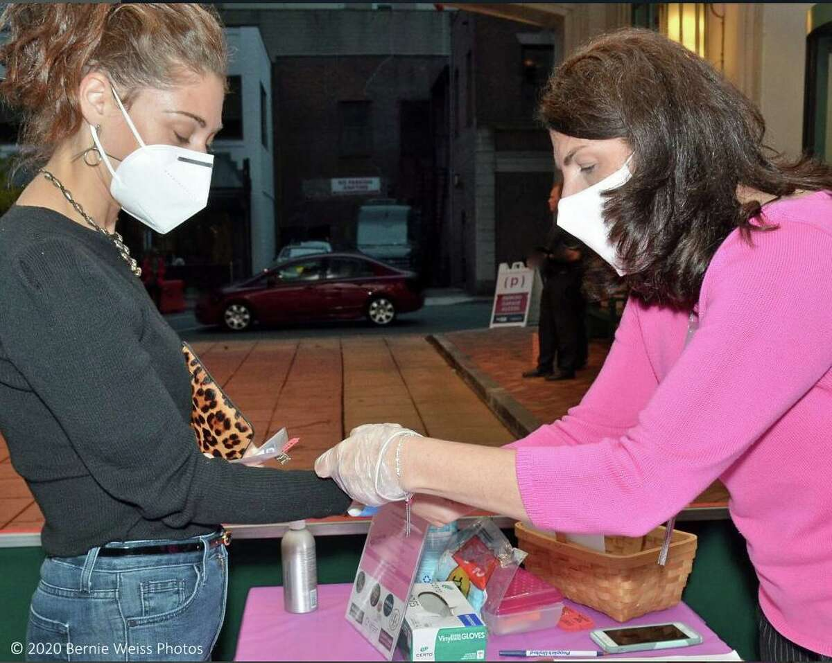 People gathered at the Courtyard and Residence Inn by Marriott in downtown Stamford or the second annual PinkFest event. The event took place in the facility's porte cochère, and is an example of how the hotel had to get creative in turning various locations on the property into event spaces during the COVID-19 pandemic, staff said. All individuals had to follow safety protocols, such as, having their temperature checked upon entry, hand sanitizing and wearing masks.