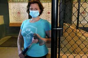 Leyla Kiosse stands in her axe-throwing business The Yard on Wednesday, Feb. 17, 2021 in Albany, N.Y. She's been told that she can't operate her business due to COVID guidelines and is filing a federal lawsuit. (Lori Van Buren/Times Union)