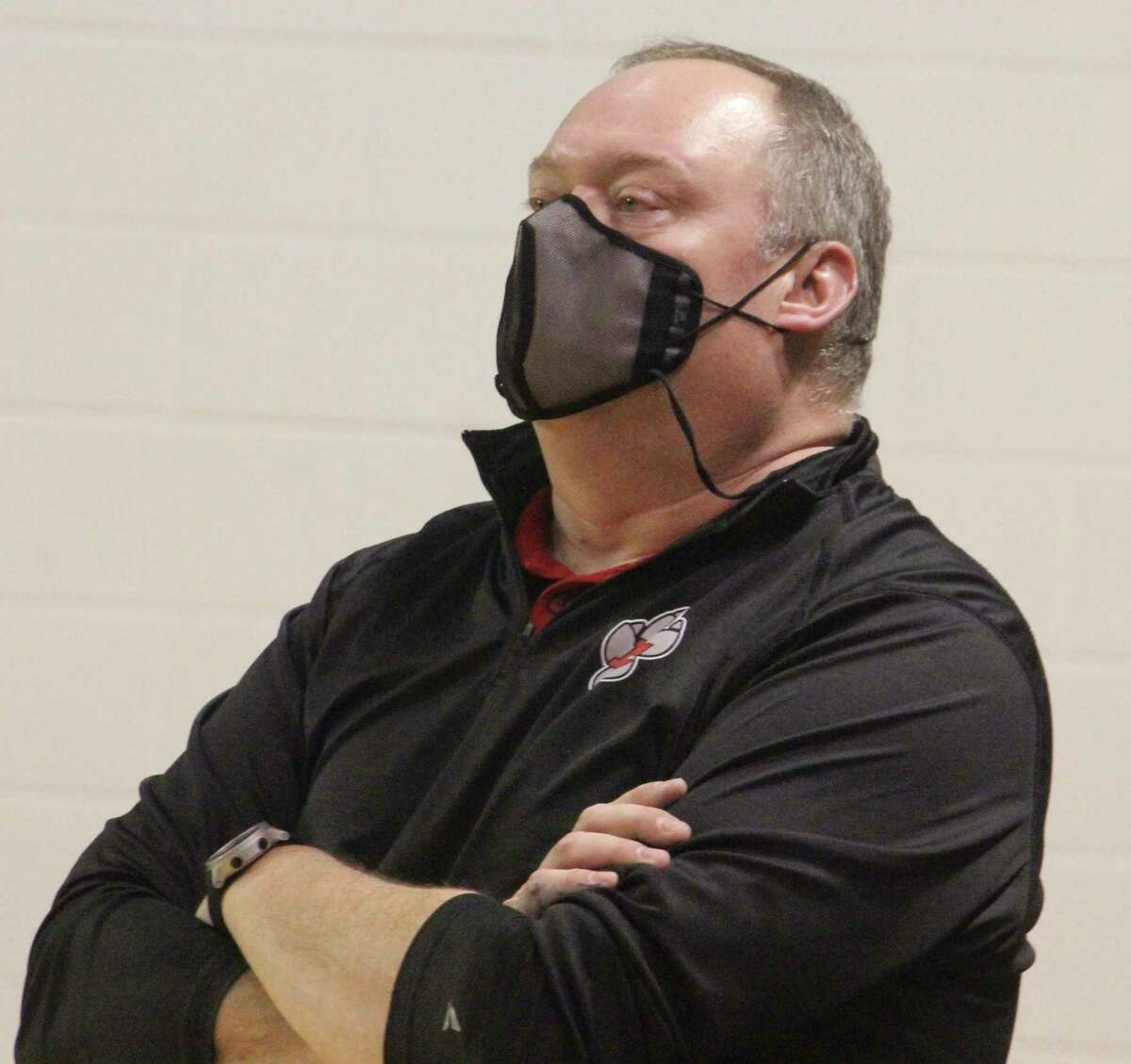 Reed City coach Jesse Kailing watches the action on Tuesday in his team's win over Big Rapids. (Pioneer photo/John Raffel)