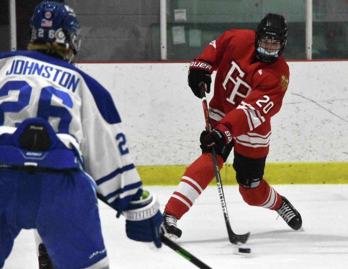 Fairfield Prep's Tiernan Curley shoots the puck against Darien at the Darien Ice House on Saturday, February 13, 2021.