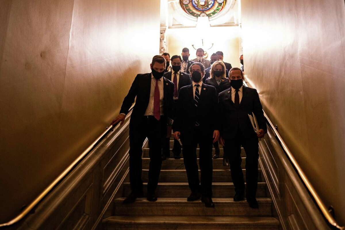 House impeachment mangers walk to a news conference after the Senate voted to acquit former President Donald Trump on Saturday, Feb. 13, 2021.