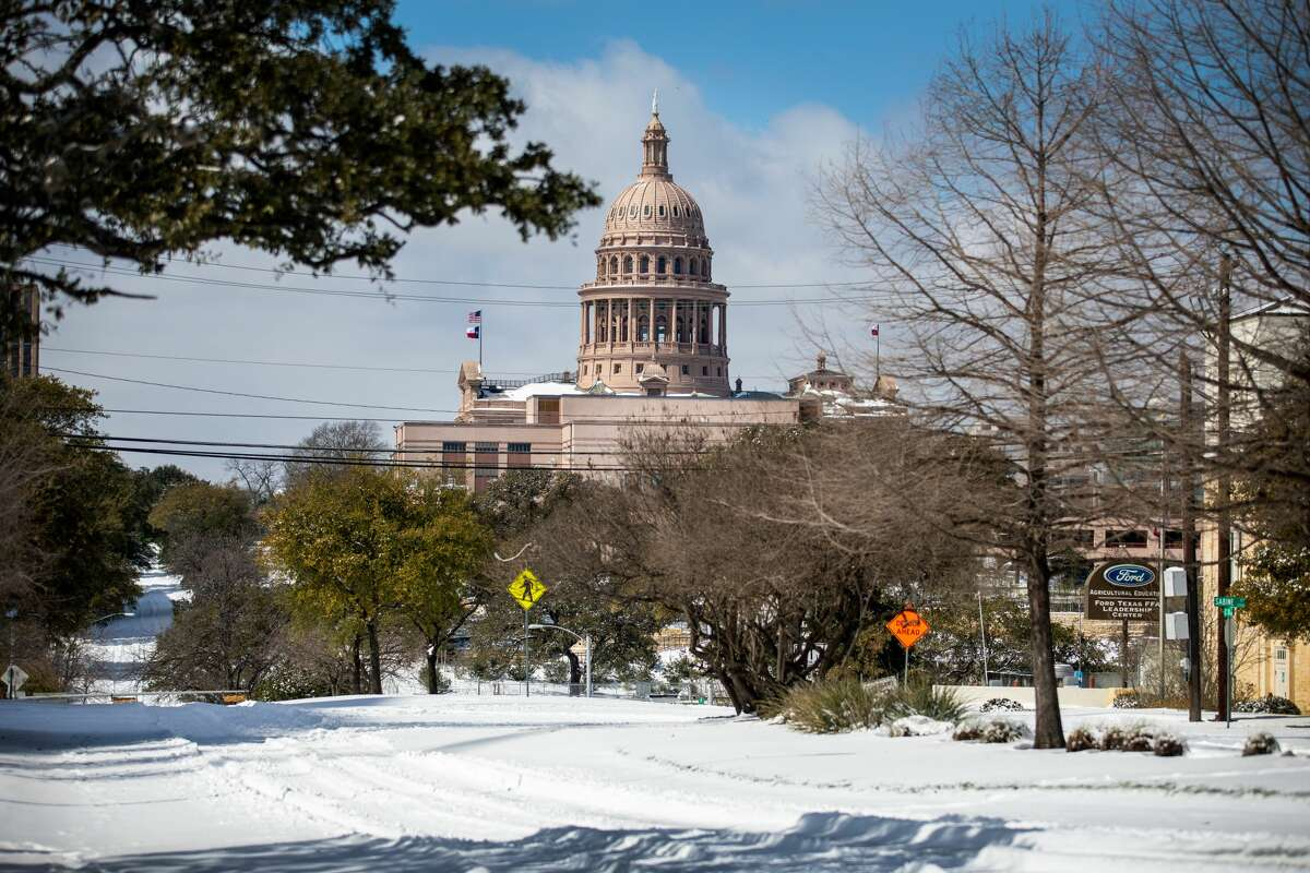 AUSTIN, TX - FEBRUARY 15: The Texas Capitol is surrounded by snow in on February 15, 2021 in Austin, Texas. Winter storm Uri has brought historic cold weather to Texas, causing traffic delays and power outages, and storms have swept across 26 states with a mix of freezing temperatures and precipitation. (Photo by Montinique Monroe/Getty Images)