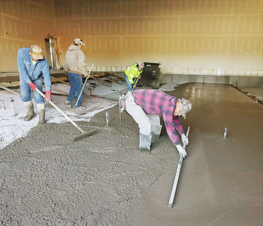 Workers pouring the tiered concrete floors in October for portions of the new eight-screen Neighborhood Cinema Group theater opening in the former Sears store space on the north end of Alton Square Mall in Alton. The Michigan-based company had wanted to have the multi-screen theater open by late 2020. A job fair will take place in the new theater from 10 a.m. to 4 p.m. on Saturday, Feb. 20, in the Alton Square Mall. Photo: John Badman|The Telegraph