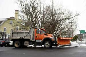 A Greenwich snow plow prepares for the anticipated afternoon snow in Greenwich last week. Those plows will be back on the street on Thursday and Town Hall is set to be closed in anticipation of the storm.