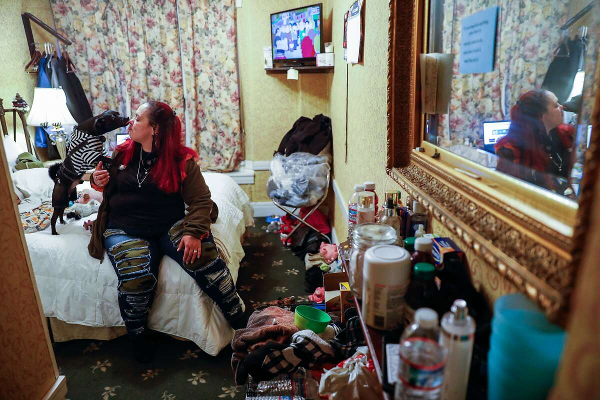 Chucky Torres, shown in her hotel room in December, hoped to get permanent housing.