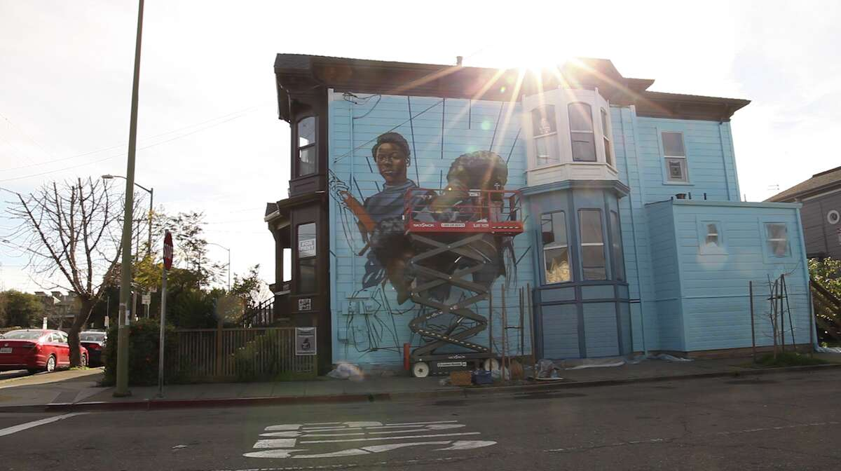 The home of Jilchristina Vest, featuring a mural dedicated to the women of the Black Panther Party.