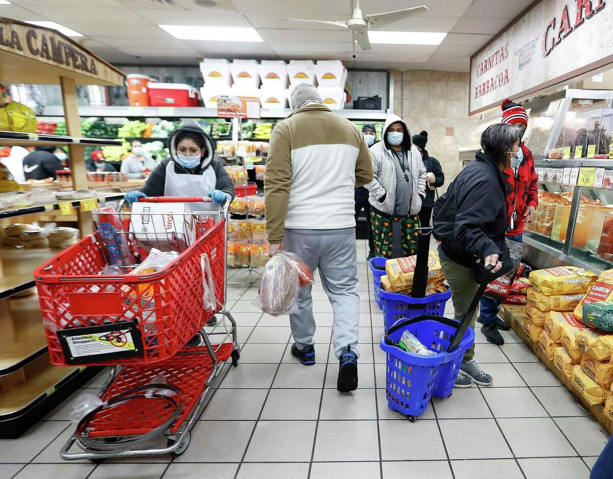 Shoppers fill the La Michoacana Meat Market on Houston's east side Wednesday, February 17, 2021, after a winter storm left people without power and water. Customers waited out the door to enter the store, a scene that played out across the region.