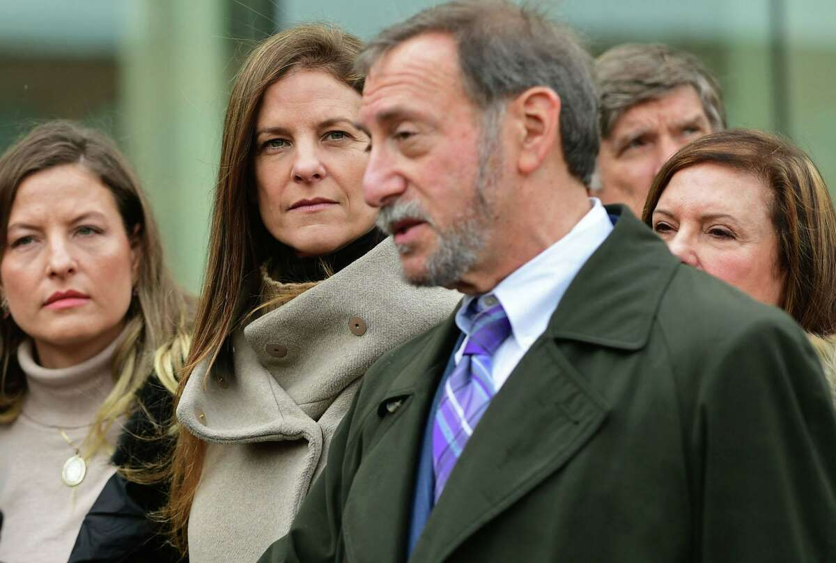 Michelle Troconis with her family and attorney Jon L. Schoenhorn.
