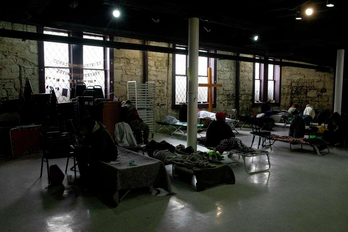 Homeless relax on their cots riding out the cold weather at an emergency warming shelter at the Travis Park Church.