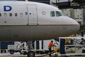 A man works on a jet at San Antonio International Airport, which has been closed since Monday because of extreme cold.