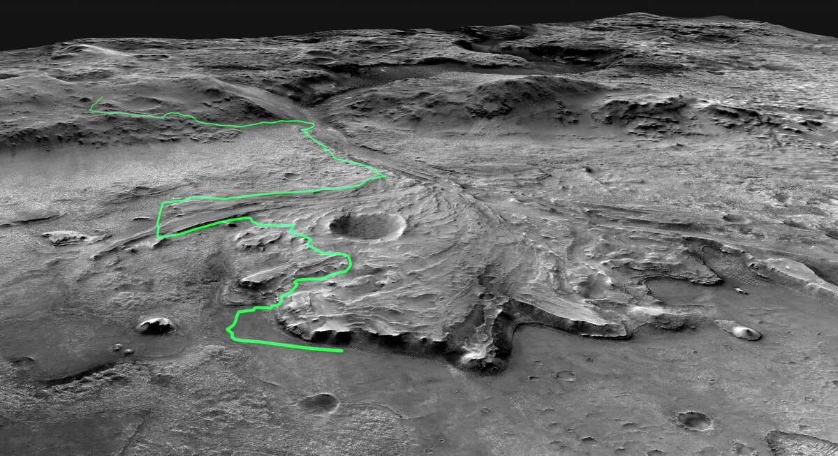 This illustration depicts a possible area through which the Mars 2020 Perseverance rover could traverse across Jezero Crater as it investigates several ancient environments that may have once been habitable. The route begins at the cliffs defining the base of a delta produced by a river as it flowed into a lake that once filled the crater. The path then traverses up and across the delta toward possible ancient shoreline deposits and then climbs the 2,000-foot-high crater rim to explore the surrounding plains. About half of this journey could be completed in Perseverance's prime mission (one Mars year, or two Earth years). For reference, the prominent crater near the center of the image is about 0.6 miles across.