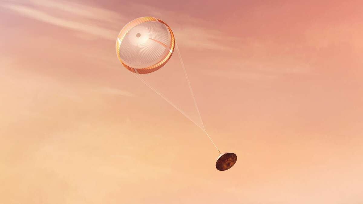 NASA's Perseverance rover deploys a supersonic parachute from its aeroshell as it slows down before landing, in this artist's illustration.