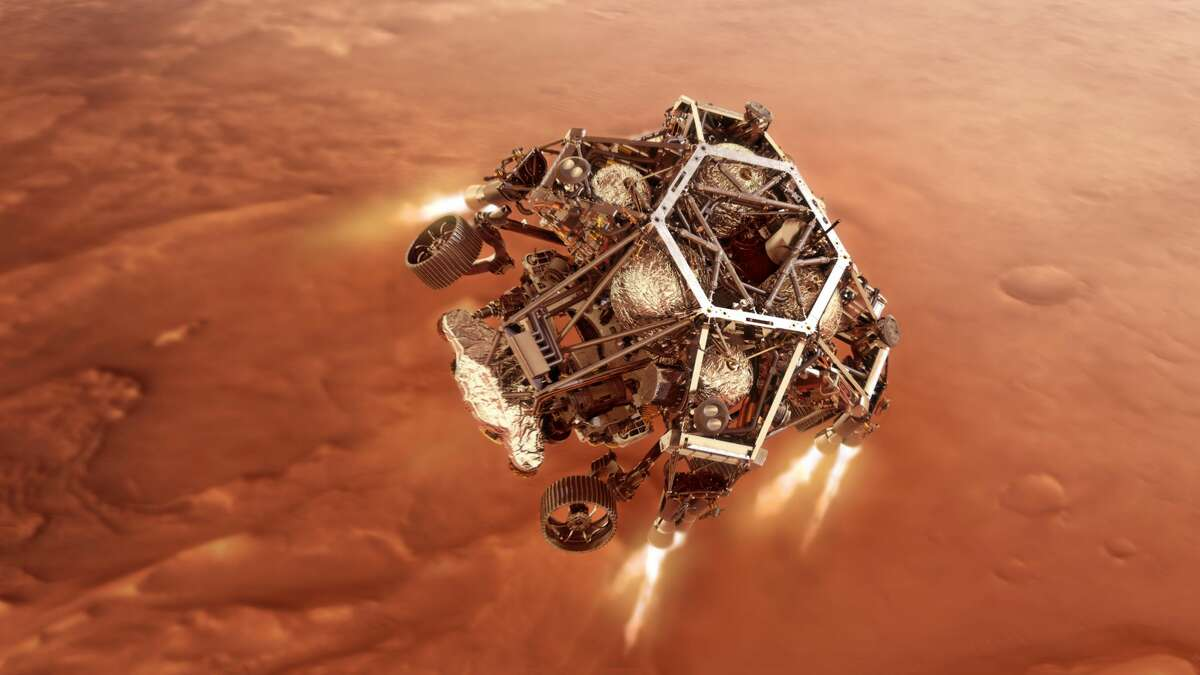 NASA's Perseverance rover fires up its descent stage engines as it nears the Martian surface in this illustration.