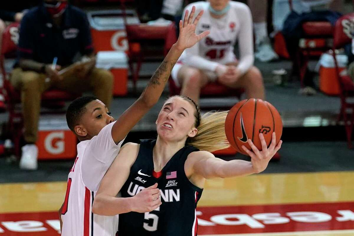 St. John's guard Kadaja Bailey (30) fouls UConn guard Paige Bueckers during the second quarter of Wednesday's game in New York.
