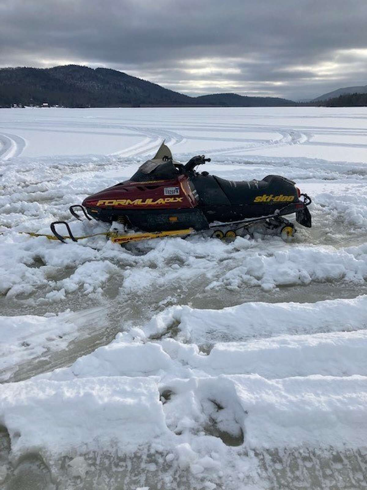 This is one of the snowmobiles stuck in slushy ice atop Lewey Lake near Indian Lake in Hamilton County on Feb. 17, 2021.