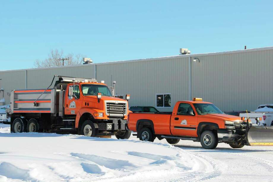 The road commission has been working non-stop to keep the roads clear during this week's snowstorm. (Robert Creenan/Huron Daily Tribune)
