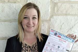 Chamber Special Events director Shelby Griffin holds one of The Taste Local Flavor Tour cards. Visits to establishments listed on the card qualify the holder for prizes, while supporting local businesses.