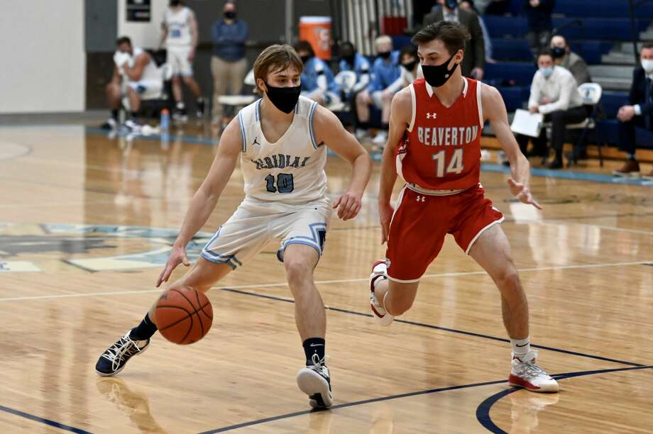 Meridian's Jack Murphy brings the ball upcourt during last Wednesday's rivalry game against Beaverton. Murphy led the Mustangs with 17 points in Monday's win over Gladwin. (Daily News file photo) Photo: (Adam Ferman/for The Daily News)