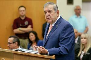 Cibolo City Manager Robert Herrera speaks at a meeting of the Cibolo City Council and the Guadalupe County Commissioners Court at Cibolo City Hall to welcome AW Texas Inc., owned by Aisin, a Fortune Global 500 company, to town in 2019. Landing the auto transmission firm in 2019 stands as defining moment of Herrera's tenure as city manager in Cibolo.