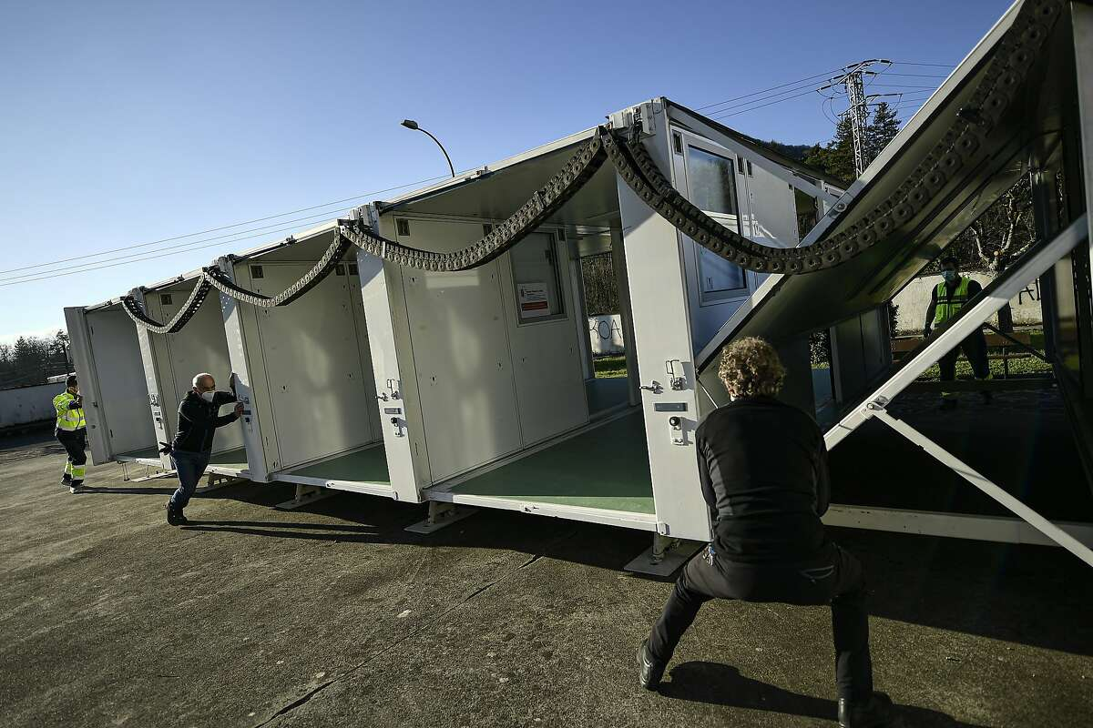 A mobile health unit is shown in the Pyrenees village of Oronoz-Mugaire in northern Spain in January. San Francisco plans to vaccine its homeless population in part by using mobile units.