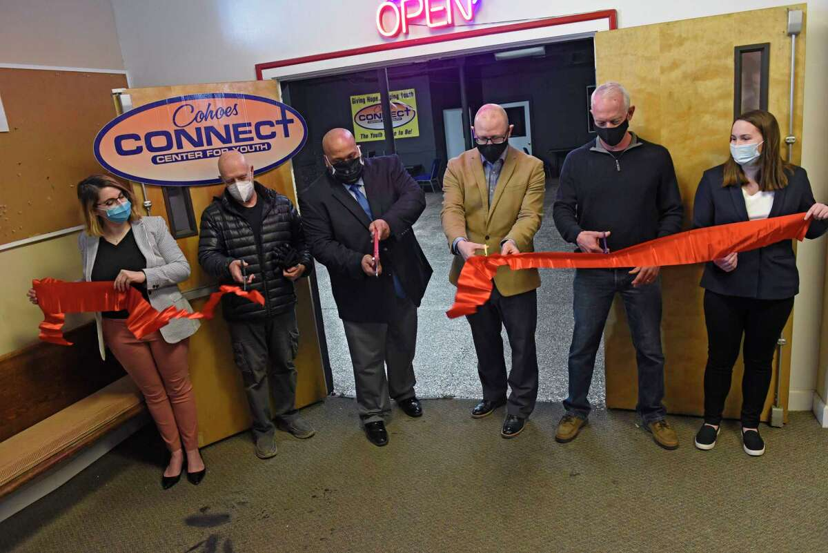 Connect Center Executive Director Ben Williams, third from left, and other city officials and center contributors participate in a ribbon cutting ceremony for Connect Center Music Studio & Connect Lab on Wednesday, Feb. 17, 2021 in Cohoes, N.Y. Connect Center Music Studio & Connect Lab is a new space for youth to access technology for school work, creative work, and more. (Lori Van Buren/Times Union)