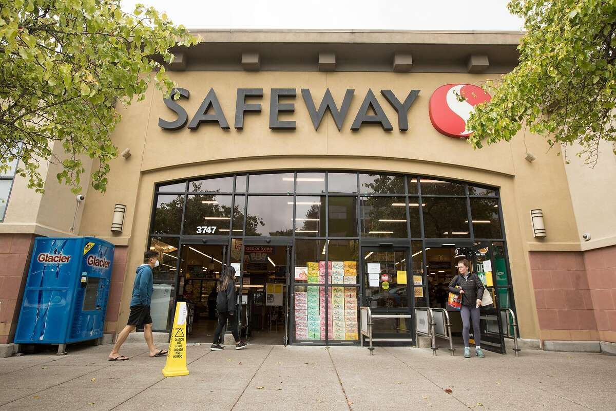 People enter a Safeway grocery store in Oakland, Calif. on March 25, 2020.