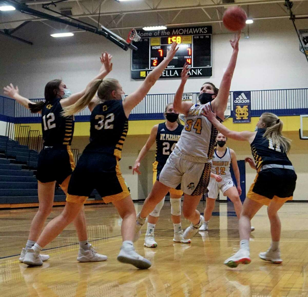 Morley Stanwood senior Brooke Brauher fights to stay upright while laying the ball up during Wednesday night's non-conference girls basketball game against Mount Pleasant. (Pioneer photo/Joe Judd)
