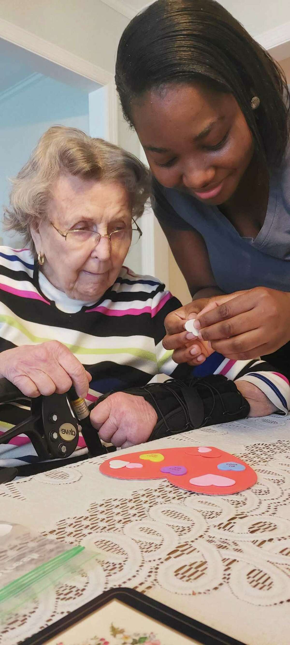 Assisted Living Services, (ALS), always takes caregiving to heart. Precious Bobson is one of the many compassionate caregivers at the home care agency who brightens up the daily life of their clients like Elaine Kuhrt with fun, and interactive activities.