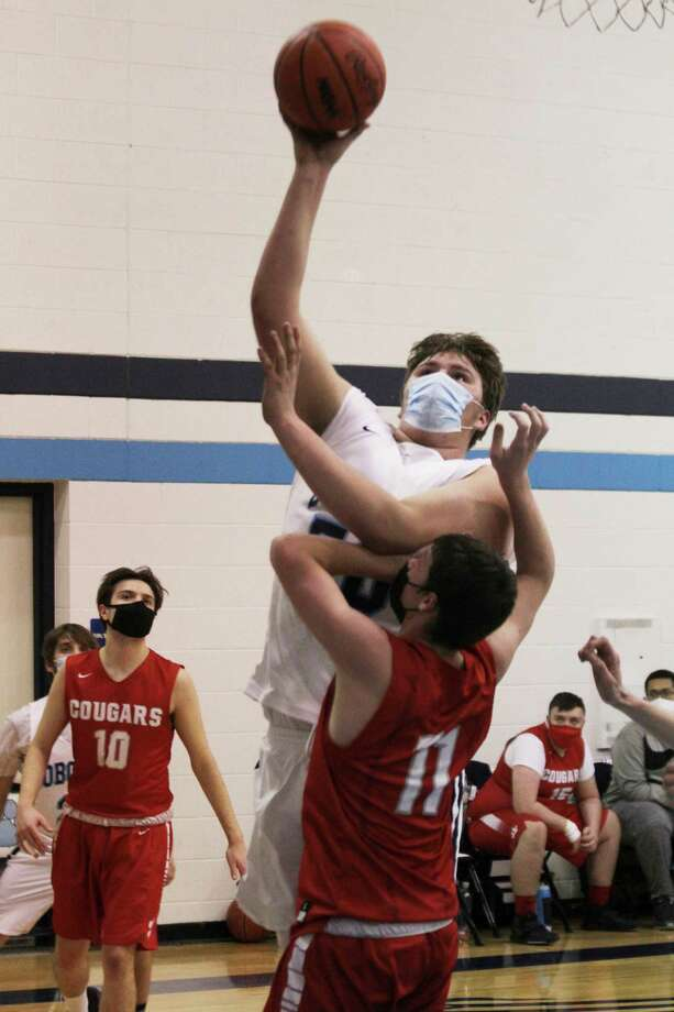 The Bobcats' Anthony Beccaria powers his way to a bucket on Wednesday in Brethren. (Dylan Savela/News Advocate)