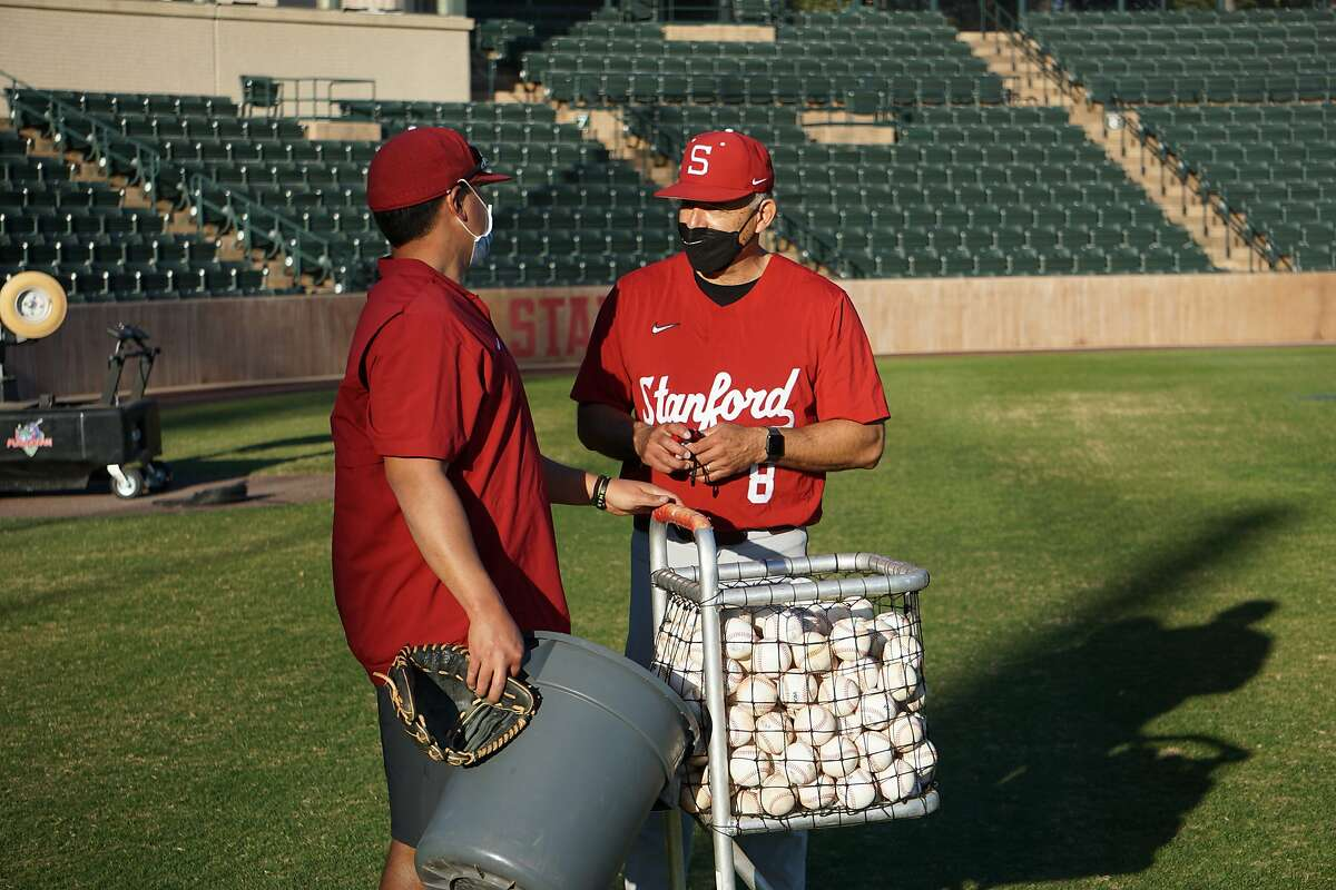 David Esquer (right) and Sky Valenzuela (left) at Stanford Baseball practice in Stanford, Calif. in February 2021.