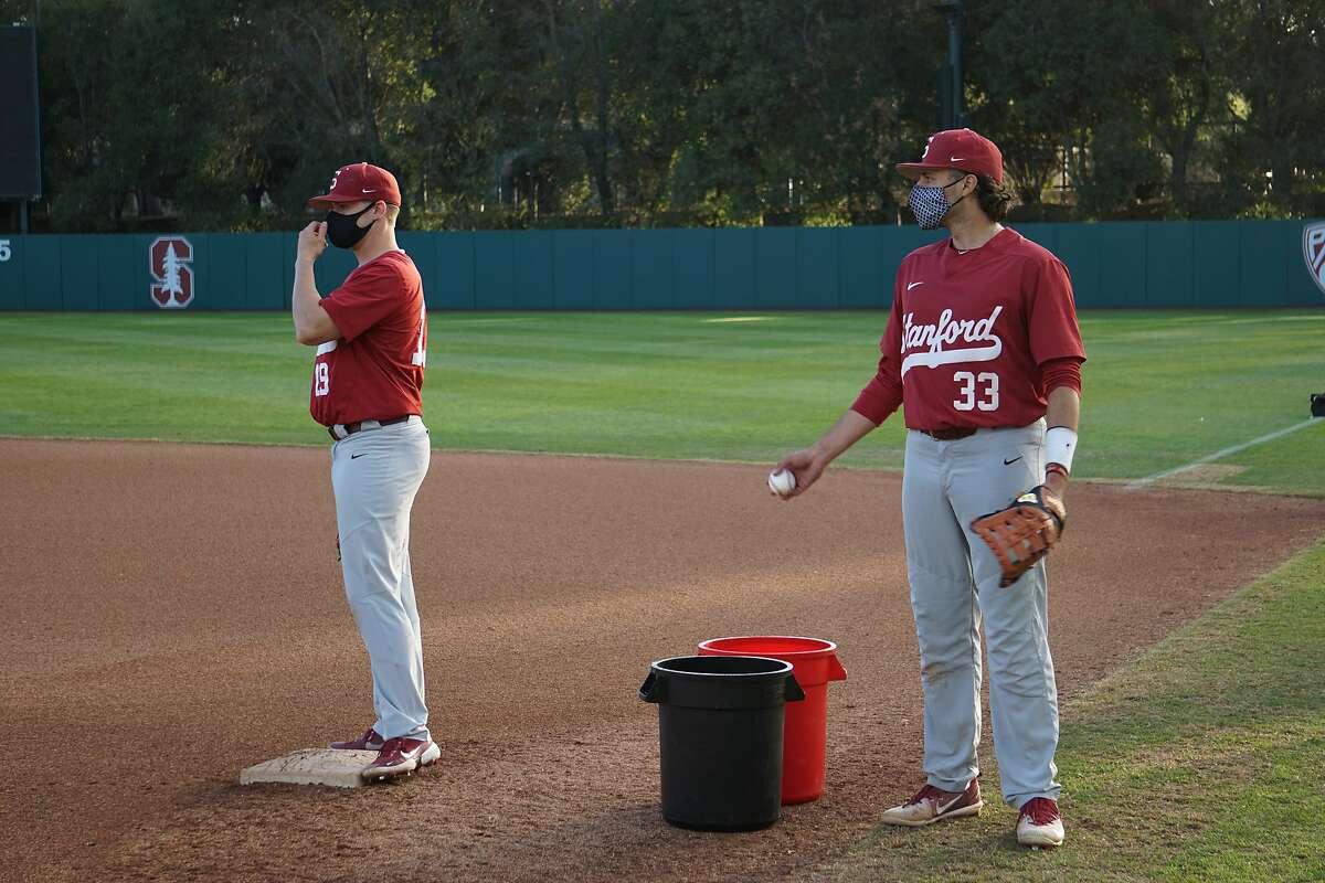 Henry Gargus (left) and Brett Barrera (right) at Stanford Baseball practice in Stanford, Calif. in February 2021.