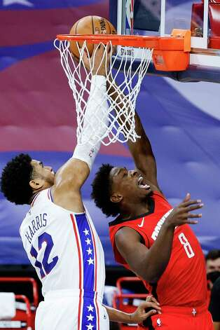 PHILADELPHIA, PENNSYLVANIA - FEBRUARY 17: Tobias Harris #12 of the Philadelphia 76ers blocks Jae'Sean Tate #8 of the Houston Rockets during the second quarter at Wells Fargo Center on February 17, 2021 in Philadelphia, Pennsylvania. NOTE TO USER: User expressly acknowledges and agrees that, by downloading and or using this photograph, User is consenting to the terms and conditions of the Getty Images License Agreement. Photo: Tim Nwachukwu, Getty Images / 2021 Getty Images