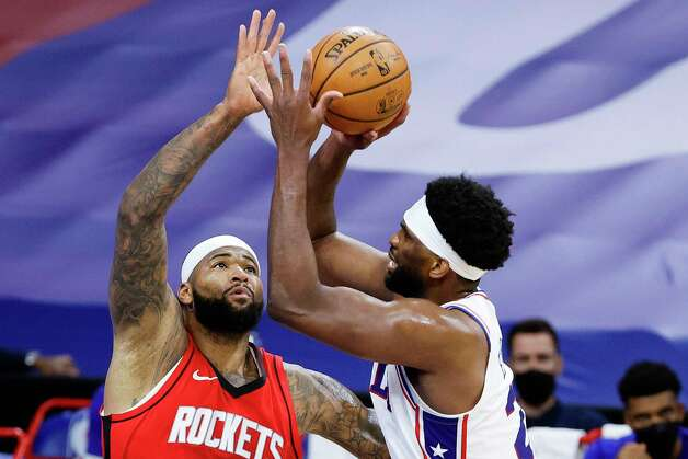 PHILADELPHIA, PENNSYLVANIA - FEBRUARY 17: DeMarcus Cousins #15 of the Houston Rockets guards Joel Embiid #21 of the Philadelphia 76ers during the second quarter at Wells Fargo Center on February 17, 2021 in Philadelphia, Pennsylvania. NOTE TO USER: User expressly acknowledges and agrees that, by downloading and or using this photograph, User is consenting to the terms and conditions of the Getty Images License Agreement. Photo: Tim Nwachukwu, Getty Images / 2021 Getty Images
