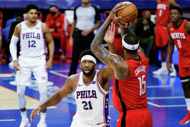 PHILADELPHIA, PENNSYLVANIA - FEBRUARY 17: Joel Embiid #21 of the Philadelphia 76ers guards DeMarcus Cousins #15 of the Houston Rockets during the second quarter at Wells Fargo Center on February 17, 2021 in Philadelphia, Pennsylvania. NOTE TO USER: User expressly acknowledges and agrees that, by downloading and or using this photograph, User is consenting to the terms and conditions of the Getty Images License Agreement. Photo: Tim Nwachukwu, Getty Images / 2021 Getty Images