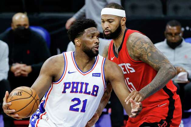 PHILADELPHIA, PENNSYLVANIA - FEBRUARY 17: Joel Embiid #21 of the Philadelphia 76ers drives to the basket past DeMarcus Cousins #15 of the Houston Rockets during the third quarter at Wells Fargo Center on February 17, 2021 in Philadelphia, Pennsylvania. NOTE TO USER: User expressly acknowledges and agrees that, by downloading and or using this photograph, User is consenting to the terms and conditions of the Getty Images License Agreement. Photo: Tim Nwachukwu, Getty Images / 2021 Getty Images