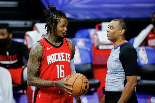 PHILADELPHIA, PENNSYLVANIA - FEBRUARY 17: Ben McLemore #16 of the Houston Rockets speaks with referee Karl Lane #77 during the third quarter at Wells Fargo Center on February 17, 2021 in Philadelphia, Pennsylvania. NOTE TO USER: User expressly acknowledges and agrees that, by downloading and or using this photograph, User is consenting to the terms and conditions of the Getty Images License Agreement. Photo: Tim Nwachukwu, Getty Images / 2021 Getty Images